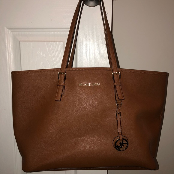 68db175117ed Jet Set Travel Medium Saffiano Leather TopZip Tote.  M 5b72287e5bbb809a58d09af9. Other Bags you may like. Michael Kors ...